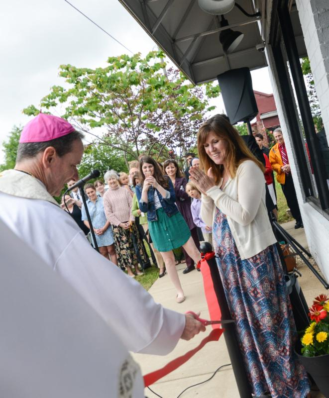 Bishop Burbidge cuts the ribbon with Kathleen Wilson. (May 6, 2017)