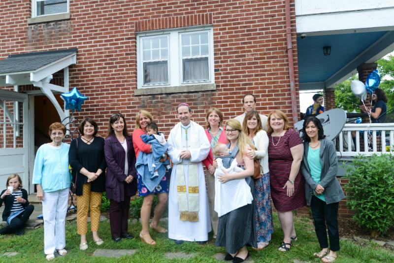 Bishop Burbidge blesses and poses with the staff and volunteers. (May 6, 2017)