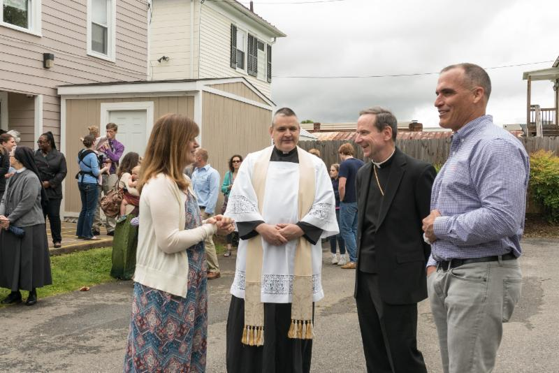 Mary's Shelter Director Kathleen Wilson welcomes Bishop Burbidge, Father Mosimann, and Mark Doherty of MacDoc Property Management. (May 6, 2017)